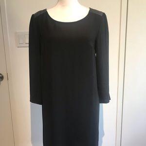Black dress with fake leather shoulder detail